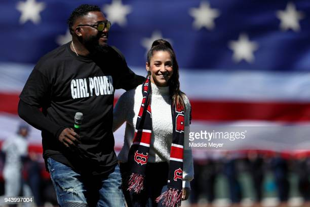 Former Red Sox player David Ortiz with American Olympic gymnast Aly Raisman before the Red Sox home opening game against the Tampa Bay Rays at Fenway...