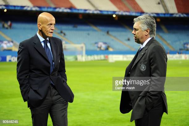 Former Referee Pierluigi Collina of Italy speaks to Chelsea Manager Carlo Ancelotti prior to Champions League Group D match between Atletico Madrid...
