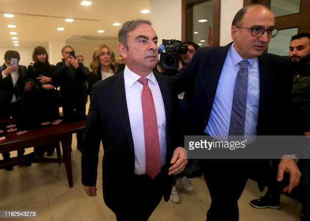 Former Renault-Nissan boss Carlos Ghosn arrives at the Lebanese Press Syndicate to address a large crowd of journalists on his reasons for dodging...