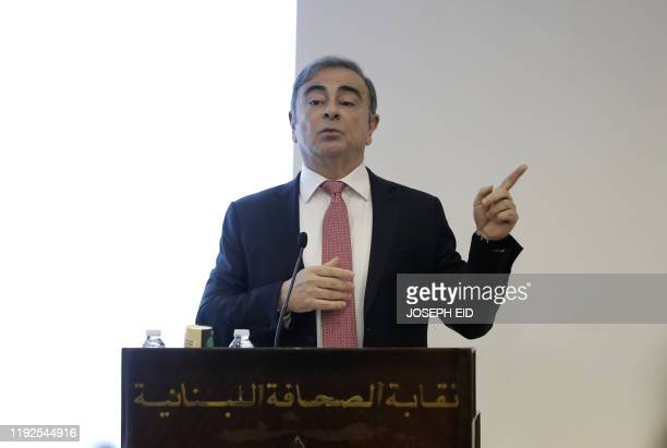 Former RenaultNissan boss Carlos Ghosn gestures as he addresses a large crowd of journalists on his reasons for dodging trial in Japan where he is...
