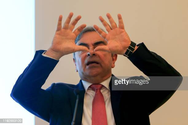 TOPSHOT Former RenaultNissan boss Carlos Ghosn gestures as he addresses a large crowd of journalists on his reasons for dodging trial in Japan where...