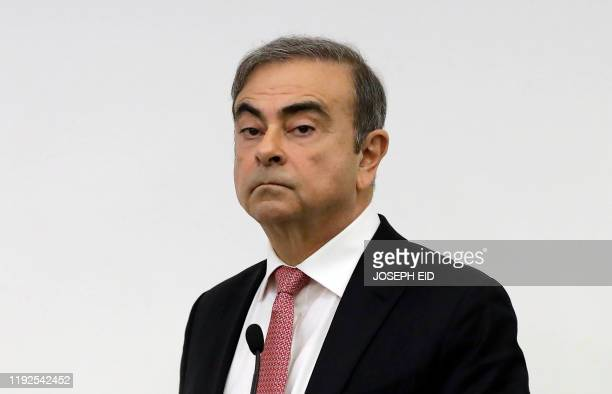 TOPSHOT Former RenaultNissan boss Carlos Ghosn looks on before addressing a large crowd of journalists on his reasons for dodging trial in Japan...