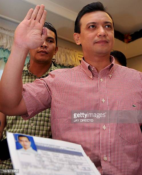 Former renegade naval officer turned senator Antonio Trillanes raises his hand as he swears by the truthfulness of his application for amnesty...