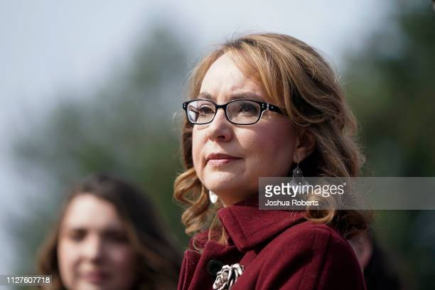 Former Rep. Gabby Giffords listens as Democratic lawmakers speak in support gun background checks legislation bill H.R. 8 on Capitol Hill on February...