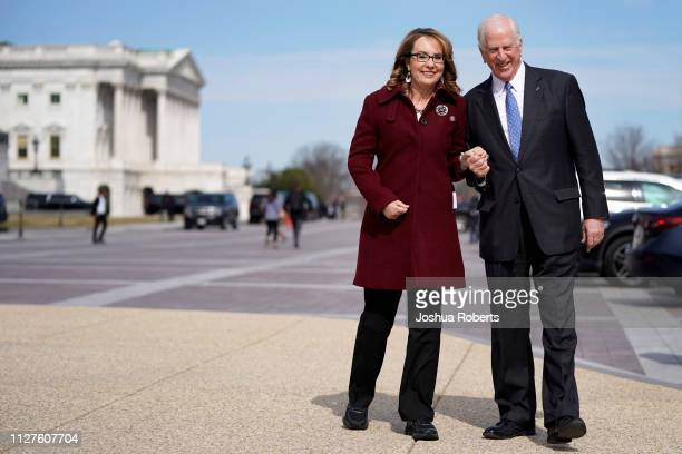 Former Rep. Gabby Giffords walks with Rep. Mike Thompson as she arrives to join Democratic lawmakers in support gun background checks legislation...