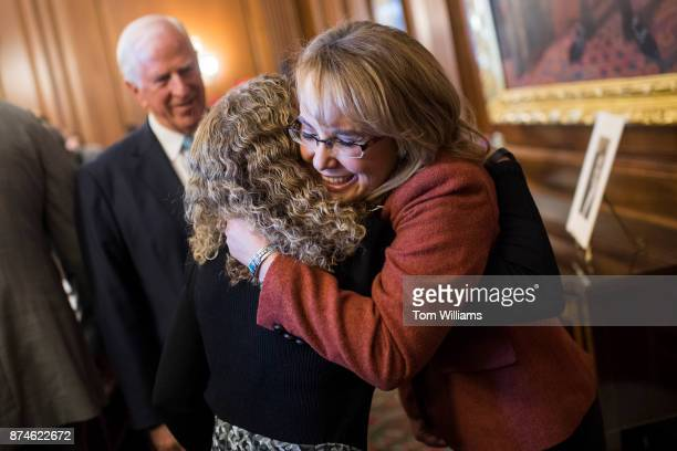 Former Rep Gabrielle Giffords DAriz right hugs Rep Debbie Wasserman Schultz DFla during a ceremony in the Capitol on November 15 to name the House...