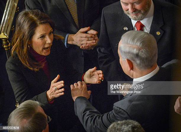 Former Representative Michele Bachmann greets Israel's Prime Minister Benjamin Netanyahu as he arrives to speak before joint session of Congress, on...