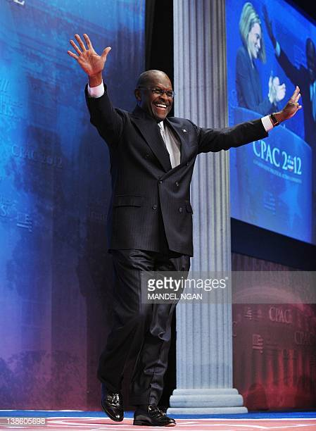 Former Republican presidential candidate Herman Cain speaks during an address to the 39th Conservative Political Action Committee February 9 2012 at...