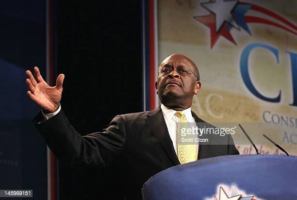 Former Republican Presidential Candidate Herman Cain speaks to guests at the Conservative Political Action Conference at the Donald E Stephens...