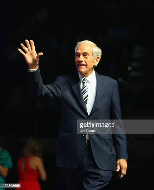 Former Republican presidential candidate US Rep Ron Paul waves as he arrives for a rally in the Sun Dome at the University of South Florida on August...