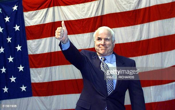Former Republican presidential candidate US Senator John McCain waves to the crowd 11 August 2000 at The University of Portland in Oregon McCain is...