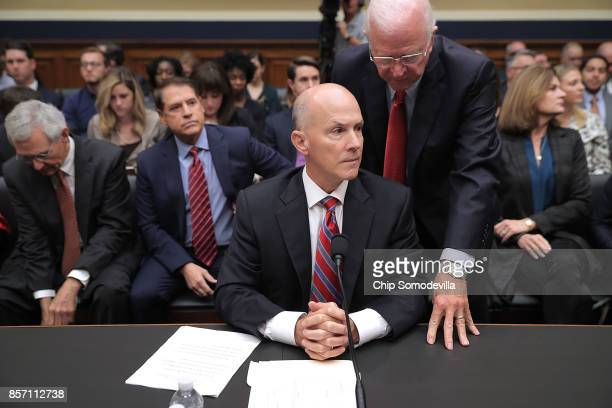 Former Republican Senator from Georgia Saxby Chambliss advises former Equifax CEO Richard Smith before he testifies to the House Energy and Commerce...