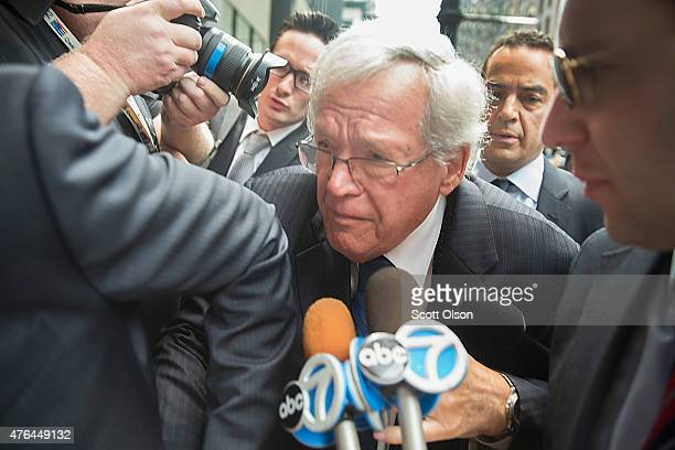 Former Republican Speaker of the House Dennis Hastert fights his way through the press as he arrives for his arraignment at the Dirksen Federal...