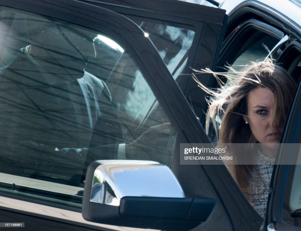 Former Republican US Presidential candidate Mitt Romney (L) gets into a SUV with an unidentified woman after having lunch at the White House November 29, 2012 in Washington, DC. Former Governor Mitt Romney met with Obama after losing the 2012 US Presidential Election to him earlier this month. AFP PHOTO/Brendan SMIALOWSKI