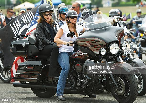 Former Republican vice presidential candidate and Alaska Governor Sarah Palin rides during the May 29 2011 'Rolling Thunder' Memorial Day weekend...