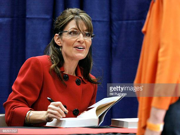 Former Republican vice presidential candidate and Alaska Governor Sarah Palin signs her new book Going Rogue for a customer at a Barnes Noble...