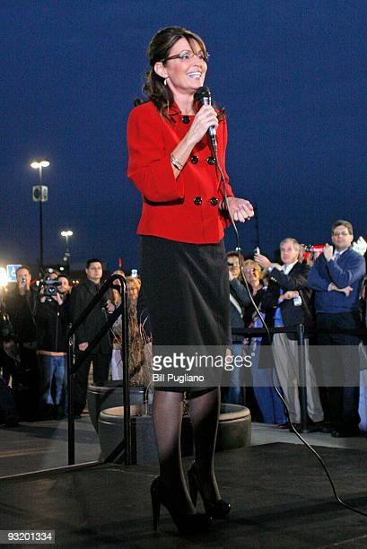 Former Republican vice presidential candidate and Alaska Governor Sarah Palin speaks briefly to a crowd of fans as she arrives for a book signing...