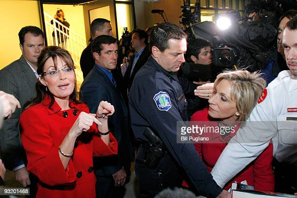 Former Republican vice presidential candidate and Alaska Governor Sarah Palin talks with NBC reporter Andrea Mitchell as she arrives for a book...
