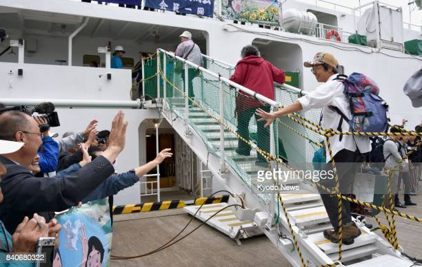 Former residents of disputed islands off Japan's northernmost main island of Hokkaido leave for the Habomai islet group from Nemuro on Aug 30 to...