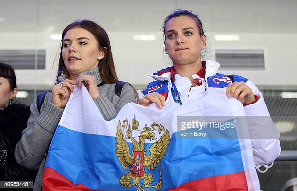 Former rhythmic gymnast Alina Kabayeva and pole vaulter Yelena Isinbayeva of Russia are upset after the Men's Ice Hockey Preliminary Round Group A...