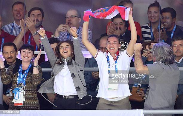 Former rhythmic gymnast Alina Kabayeva and pole vaulter Yelena Isinbayeva of Russia attend the Men's Ice Hockey Preliminary Round Group A game...