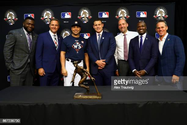 Former Roberto Clemente Award winners pose for a photo with 2017 winner Anthony Rizzo of the Chicago Cubs during the Roberto Clemente Award press...