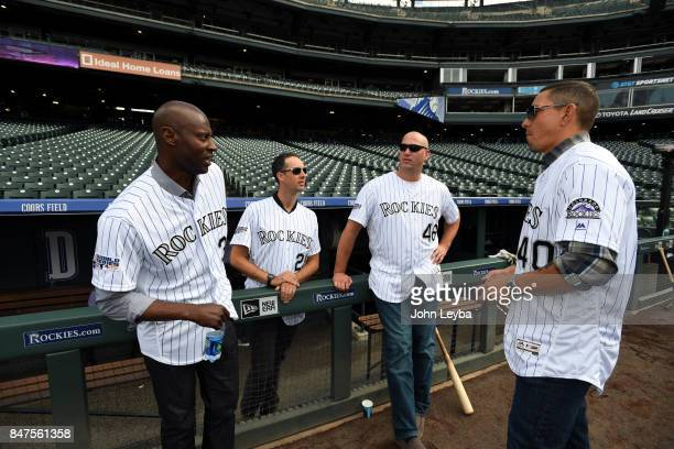 Former Rockies players LaTroy Hawkins Jeff Francis Zach McClellan and Brian Fuentes chat before the game with the San Diego Padres on September 15...