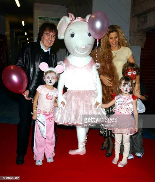 Former Rolling Stones bass player Bill Wyman and family pose with children's TV star Angelina Ballerina during the Nutcracker premiere preperformance...