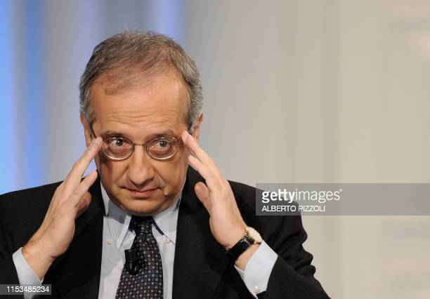 """Former Rome's mayor and head of the newly formed center-left Democratic Party leader Walter Veltroni gestures during the broadcast """"Porta a Porta"""" on..."""
