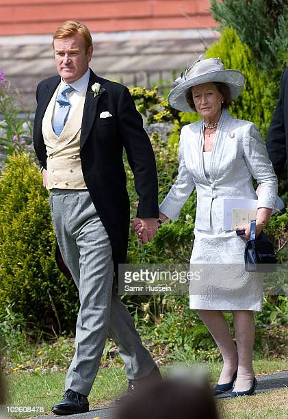 Former Royal Equerry Mark Dyer and arrives with his mother to marry Amanda Kline at St Edmund's Church on July 3 2010 in Abergavenny Wales