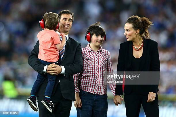 Former rugby league player Andrew Johns embraces his wife Cathrine Mahoney and his two son's Louis Byron and Samuel at halftime during the 2012 NRL...