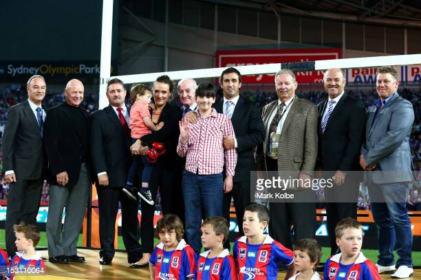 Former rugby league player Andrew Johns poses with his family and six of the rugby league Immortals at halftime during the 2012 NRL Grand Final match...