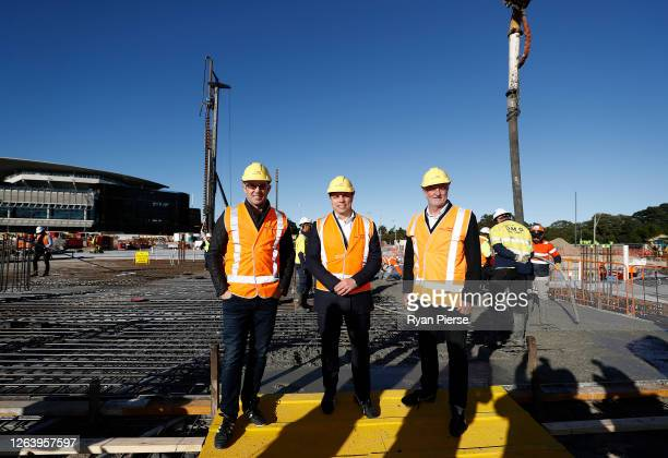 Former Rugby League player Brad Fittler Former Rugby Union player Phil Waugh and Socceroos Coach Graham Arnold pose as they lay the prints of their...
