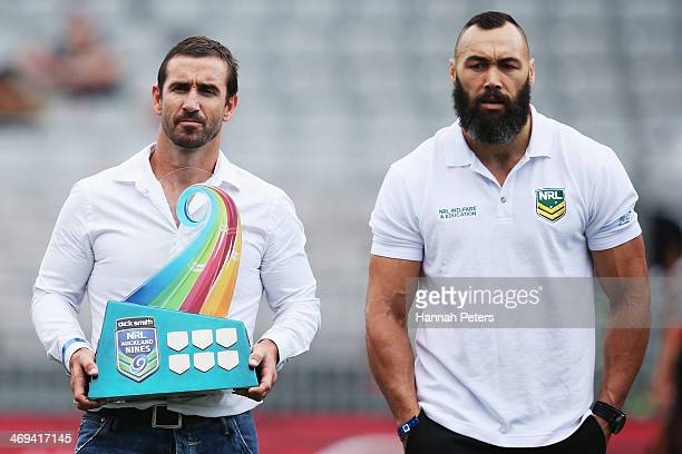 Former rugby league players Andrew Johns and Wairangi Koopu carry the NRL Auckland Nines trophy out during the opening ceremony prior to the start of...