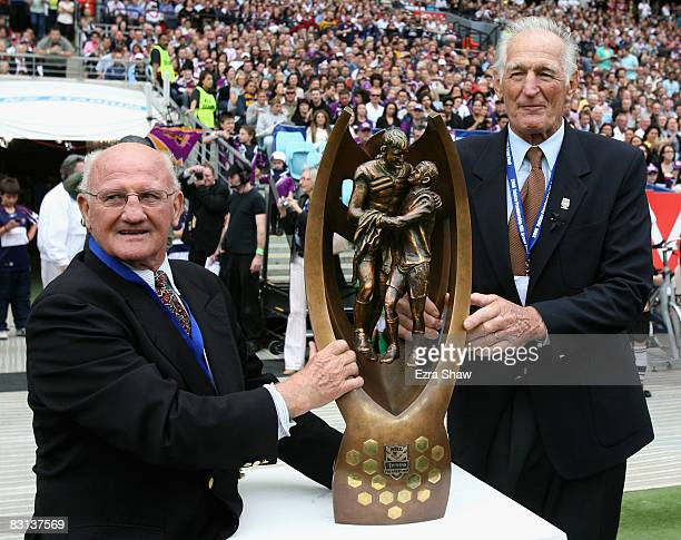 Former rugby league players Arthur Summons and Norm Provan pose with the NRL Premiership trophy before the NRL Grand Final match between the Manly...