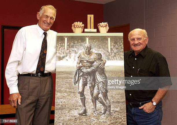 Former rugby league players Norm Provan and Arthur Summons pose with a picture of themselves from the 1963 NSW Rugby League Premiership Grand Final...