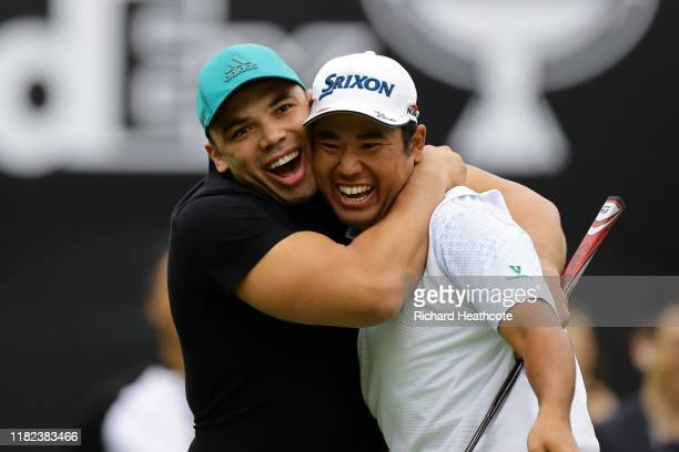 Former rugby player Bryan Habana of South Africa congratulates Hideki Matsuyama of Japan after the birdie on the 7th green during The Challenge Japan...