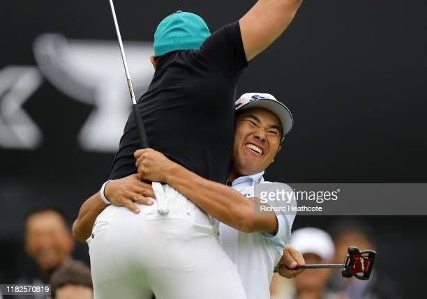 Former rugby player Bryan Habana of South Africa congratulates Hideki Matsuyama of Japan after the birdie on the 7th green during The Challenge:...