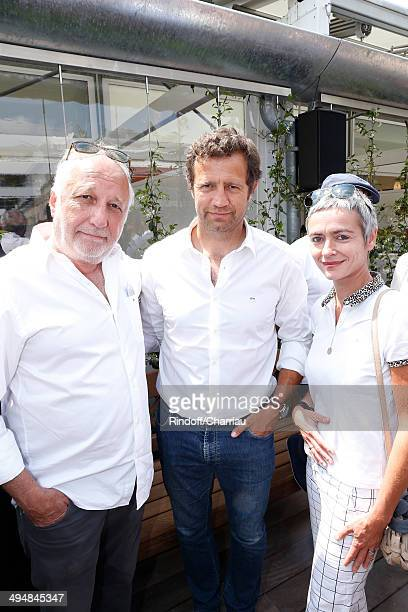 Former rugby player Fabien Galthie standing between actor Francois Berleand with his wife Alexia Stresi attend the Roland Garros French Tennis Open...