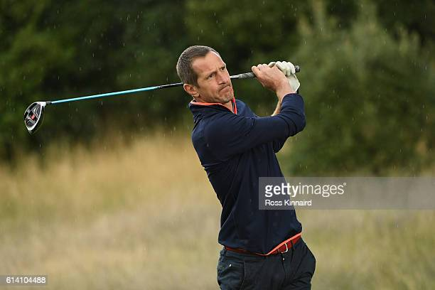 Former rugby player Will Greenwood hits his tee shot on the second hole during the Hero ProAm at The Grove on October 12 2016 in Watford England