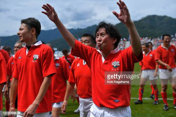 Former rugby player Yuji Matsuo applauds supporters after a legend match between Shinnittetsu Kamaishi and Kobe Steel at the Kamaishi Restoration...