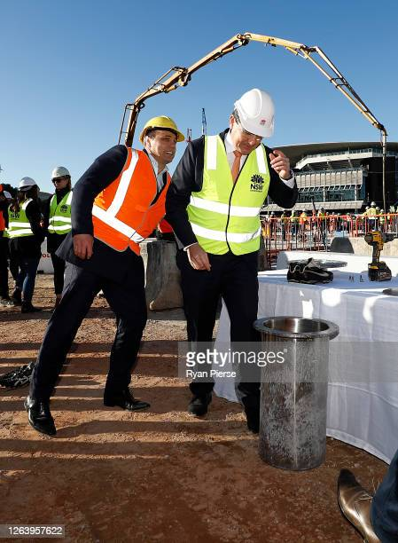 Former Rugby Union player Phil Waugh and Acting NSW Sports Minister Geoff Lee open a time capsule sealed in 1988 at the new Sydney Football Stadium...