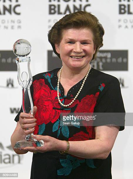 Former Russian astronaut Valentina Tereshkova holds her World Connection Award at the Women's World Award at Congress Center June 9 2004 in Hamburg...