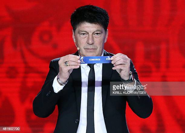 Former Russian goalkeeper Rinat Dasaev shows the name of Comoros during the preliminary draw for the Confederation of African Football zone for the...