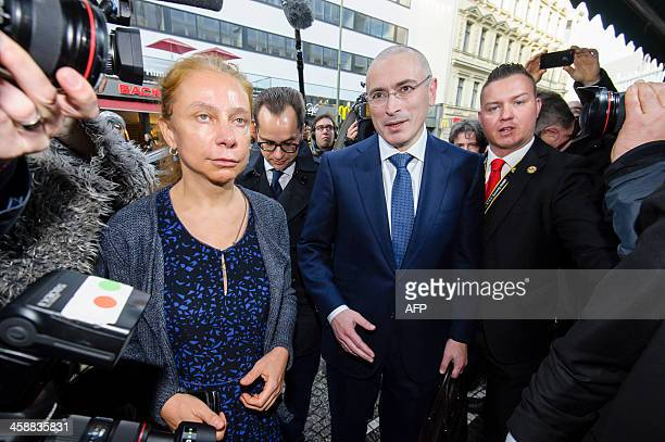 Former Russian oil tycoon and Kremlin critic Mikhail Khodorkovsky is cheerd by Wall Museum's director Alexandra Hildebrandt as he arrives at the Wall...