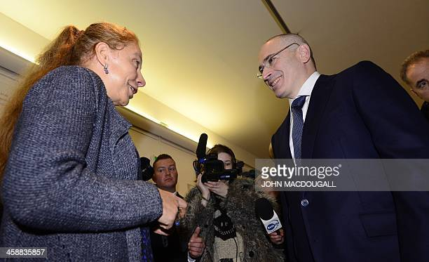 Former Russian oil tycoon and Kremlin critic Mikhail Khodorkovsky listens to Wall Museum's director Alexandra Hildebrandt as he arrives at the Wall...