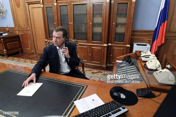 Former Russian president Dmitry Medvedev who was approved for the post of Russian Prime Minister by deputees in the State Duma works in his office at...