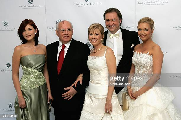 Former Russian president Mikhail Gorbachev poses with his grand-daugther Anastasia Virganskaya, daughter Irina Virganskaya , Andrei Trychachev and...