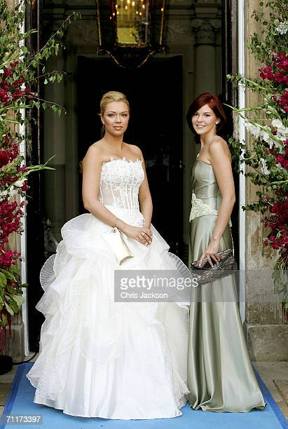Former Russian president Mikhail Gorbachev's grand-daughters Ksenia and Anastasia Virganskaya pose for a photograph as they arrive for the Raisa...