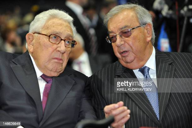 Former Russia's premier Yevgeny Primakov and former US Secretary of State Henry Kissinger speak as they take part in the annual Economic Forum in...